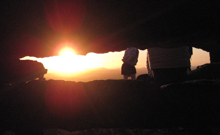 Sun setting viewed from inside Cairn G at Carrowkeel