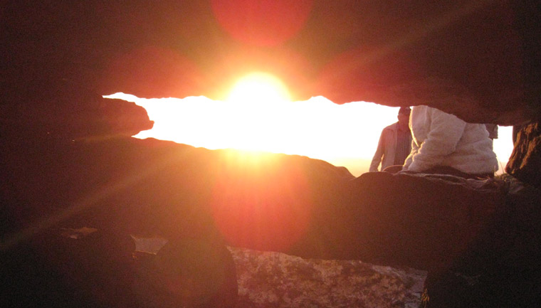 Sunset viewed through the roofbox from inside Cairn G in Carrowkeel