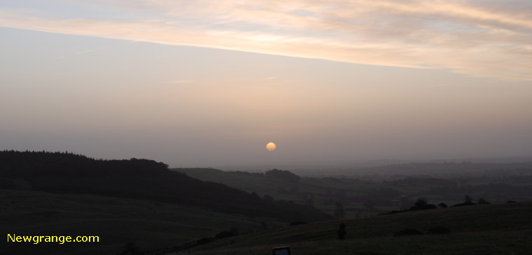 A misty sunrise at Loughcrew Cairn T